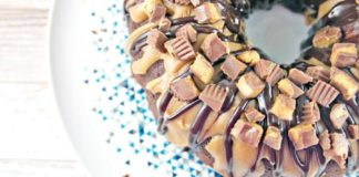 Dense chocolate cake covered in peanut butter and milk chocolate ganache, topped with chopped Reese's peanut butter cups. Must check out!