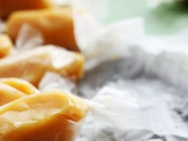 EASY soft caramels you can whip up in about 15 minutes. You don't need a candy thermometer to make these caramels and they literally melt in your mouth!