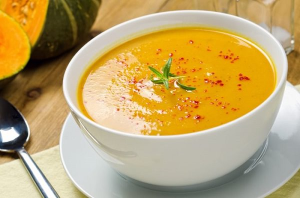 18935838 - a hot bowl of creamy squash soup with rosemary and paprika.